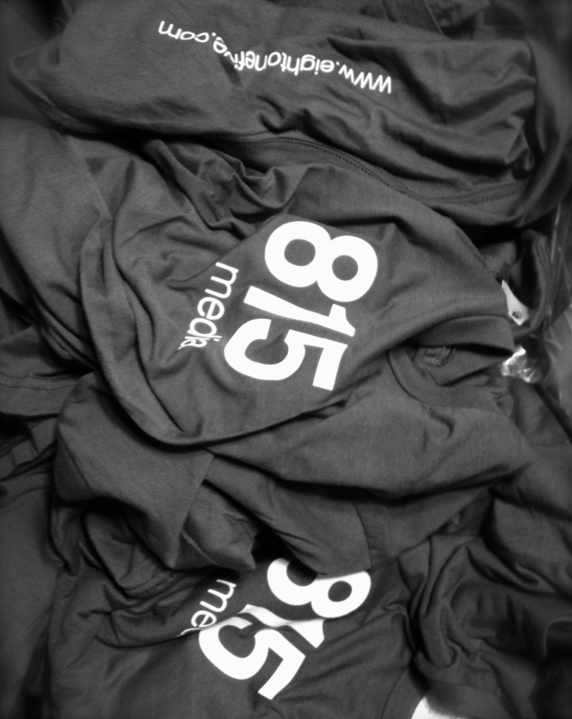 Pile of famous 815 Media t-shirts